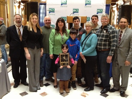 Outstanding young farmers connecticut agriculture information council stacia monahan with her family and representatives from caic and the ct doag workwithnaturefo